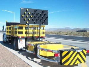 Contract sweeping services attenuator on the highway.