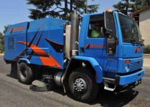 Blue sweeping truck